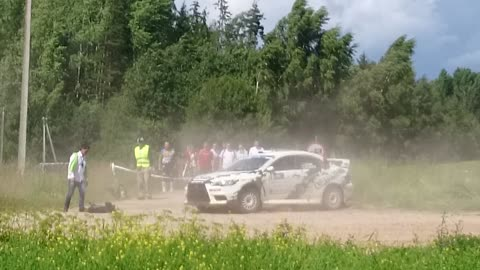 Rally car crashes, barely misses cameraman