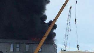Crane Saves Man on Rooftop - Video