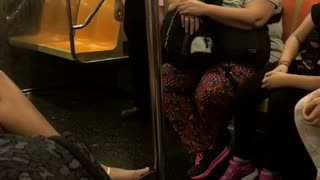 Asian guy pink shirt glasses wiggling subway dance - Video
