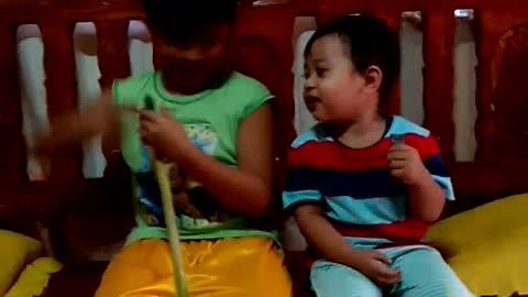 Baby laughs at the sound of a homemade trumpet