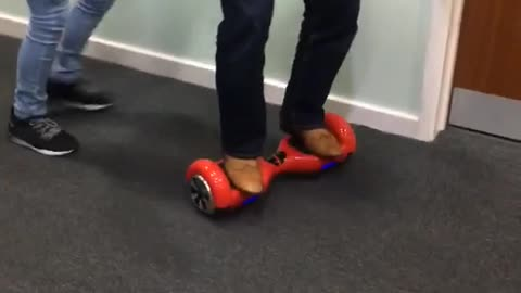 Man in red hover board pushed and falls