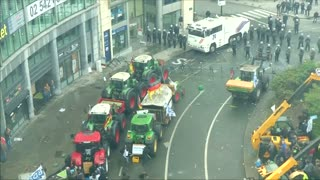 Farmers set bales of hay on fire at protest in Brussels