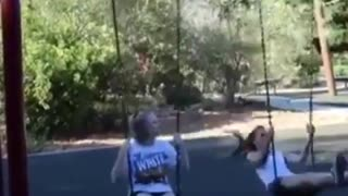Two girls swing one falls - Video