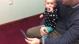 Baby laughs at her own videos! - Video