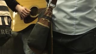 Group of men playing instruments on subway train