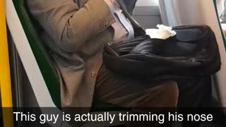 Man trimming nose hairs on train suit  - Video