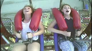 Young Woman Faints From Fear On Rollercoaster Ride - Video