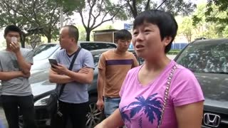 Families of missing fire fighters demand answers in Tianjin - Video