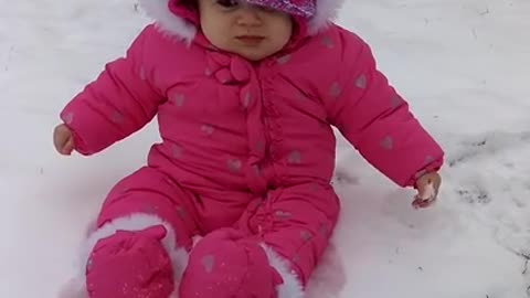 Baby experiences snow for the first time, has priceless reaction
