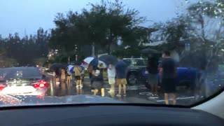 Florida Voters Not Letting Rain Stop Them!