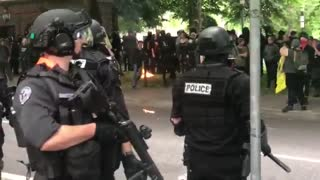 Antifa burns American flags as protesters clash in Portland - Video
