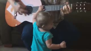cute baby daddy guitar performance  - Video