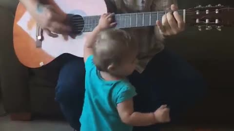 cute baby daddy guitar performance