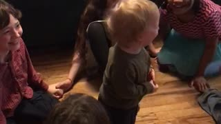 Toddler finds game of ring-around-the-rosy absolutely hysterical