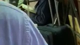 Woman shaking while reading at train station