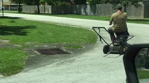 A Clever Way to Mow a Lawn on a Hot Day