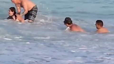 Woman Gets Repeatedly Wiped Out By Sea