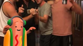 Guy karaoke singing with snapchat dancing hot dog - Video