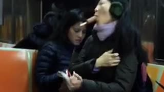 Woman suck brown popsicle no hands on subway - Video