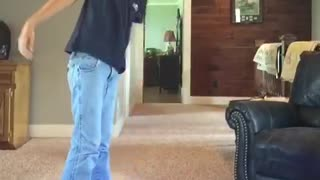 Blue shirt kid tries 180 jump on segway falls on carpet
