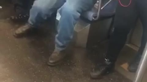 Man talks about life and marriage loudly on the phone on subway train