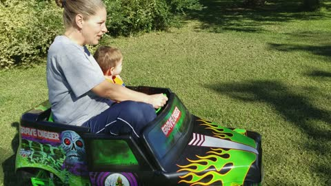 Granson gives granson a ride in grave digger