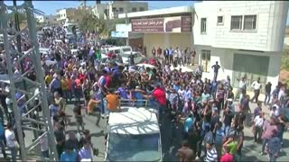 Palestinians hold funeral for man killed during attack on Israeli forces - Video