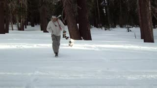 Young Man Faceplants Into Snow While Running Toward The Camera