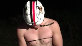 Guy in underwear and white helmet hits head opens beer  - Video