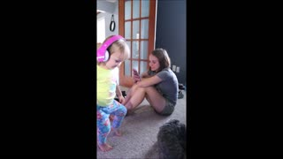 Toddler humorously dances with wireless headphones
