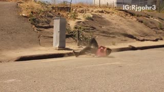 Guy skateboard jump hill fail hits head on curb cement - Video