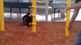 Playground zipline falls on back - Video