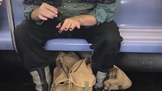 Man dressed as pirate doing nails on subway - Video