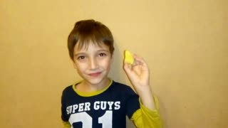 The child tries fresh ginger for the first time.
