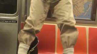 Older guy doing pull ups on subway  - Video