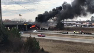 Truck Catches Fire after Colliding with Overpass