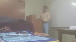 Boy is giving Presentation on Corruption in Icmap  - Video