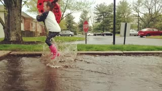 Summer Rain, Slow Motion Puddle Jump  - Video