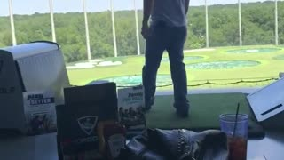Man lets go of golf club it hits the ceiling