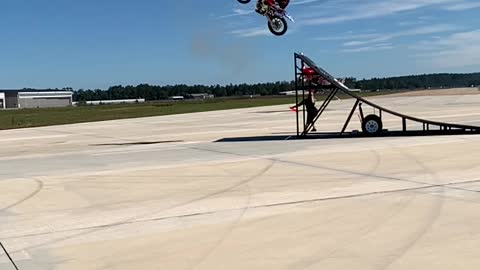 Jumping a Bi-Plane on a Motorcycle