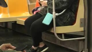 Woman on subway rubs egg on skin - Video