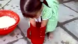 A very Very cute little girl helping her mother at home