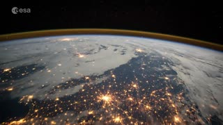 Astronaut films UK at night from International Space Station - Video