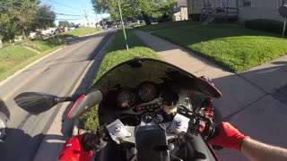 Motorcycle Vlogger Crashes After Attempt to Throw Business Cards - Video