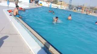 Children are swimming in the swimming pool  - Video