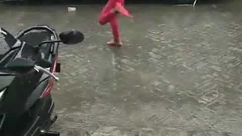 Little Girl Experiences Her Rainfall with special way