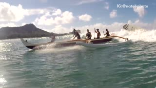 Huge canoe on beach waves
