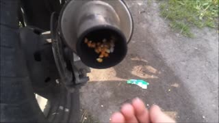 How to make popcorn with a motorcycle - Video