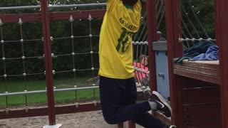 Yellow shirt kid falls off monkey bars - Video