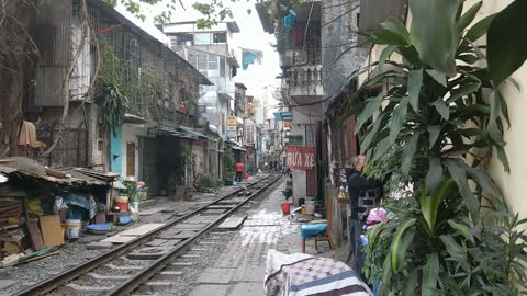 Incredible Footage Of A Train Passing Through Tiny Street In Hanoi, Vietnam